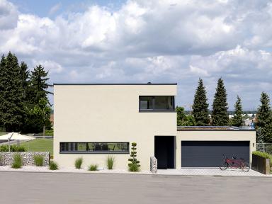 Sch ner wohnen wettbewerb einfamilienhaus im bauhaus stil for Flachdachhaus mit garage